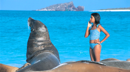Galapagos Ecuador Girl and sea lion
